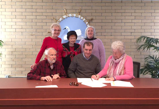 Signing Lease with town for the new Swansboro Heritage Center.